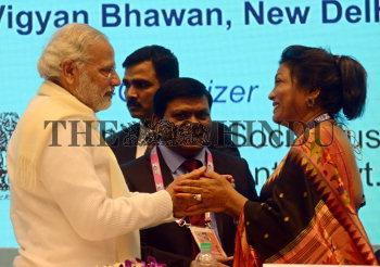 Prime Minister Narendra Modi with Kalpana Saroj, Chairman, Kamani